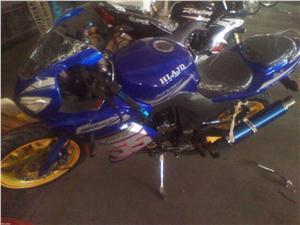 飚影150三碟摩托车